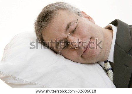 Sleeping businessman - stock photo