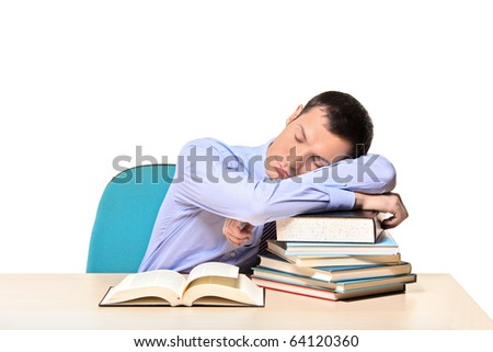 Sleeping businessman and books isolated on white background - stock photo