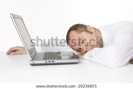 sleeping businessman with laptop
