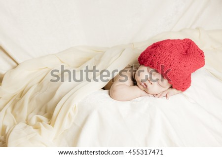 Sleeping caucasian new baby in his  silky bed - stock photo