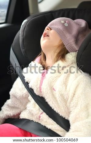 sleeping child in car seat - stock photo