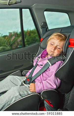 sleeping child in car seat - stock photo