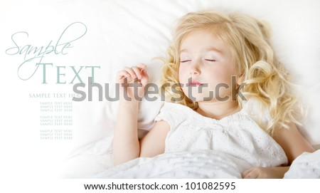 Sleeping child in white bedding room for copy space - stock photo