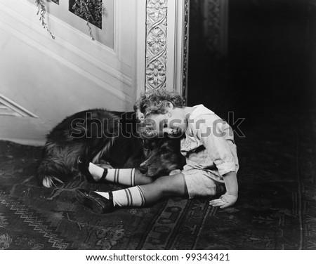 Sleeping child with dog - stock photo
