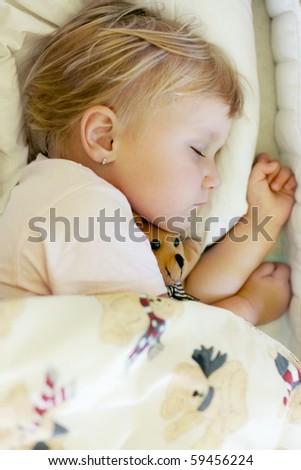 sleeping child with teddy bear - stock photo