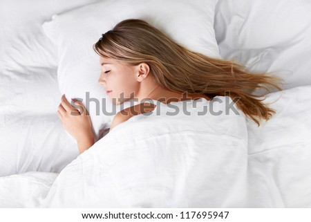 Sleeping girl in bed
