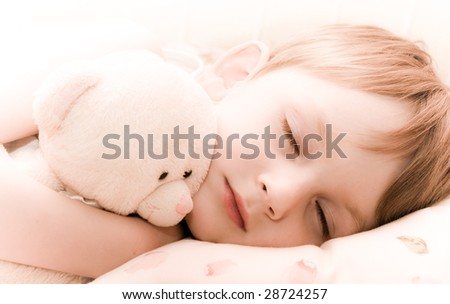 Sleeping little boy with teddy - stock photo