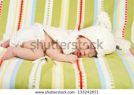 Sleeping little Easter newborn baby with bunny hat - stock photo