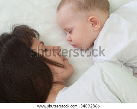 Sleeping mother and cute child in family love life
