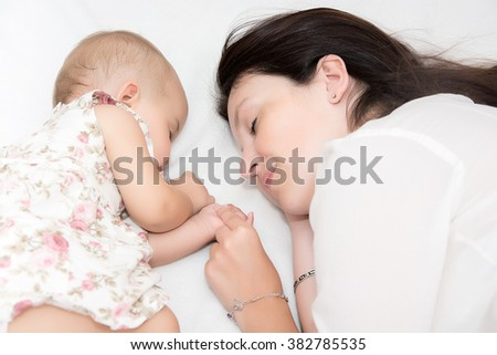 sleeping mother with her baby
