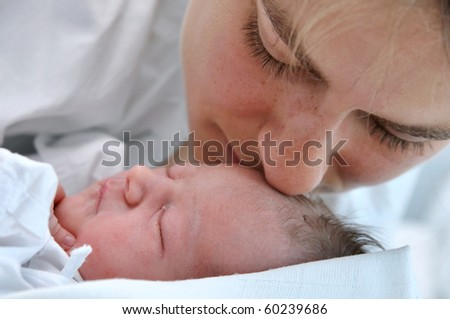 Sleeping newborn and mother - stock photo
