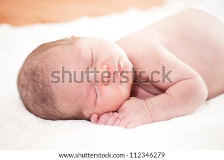 sleeping  newborn baby (at the age of 14 days) - stock photo
