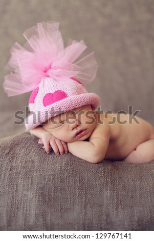 Sleeping newborn baby girl - stock photo