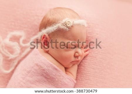 Sleeping newborn baby girl - stock photo