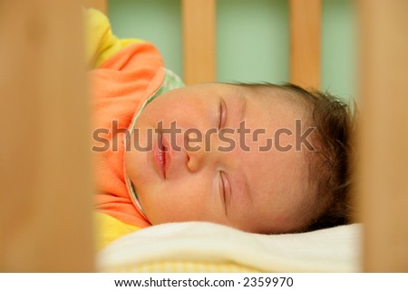 sleeping newborn baby in the bed