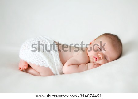 sleeping newborn baby on a blanket - stock photo