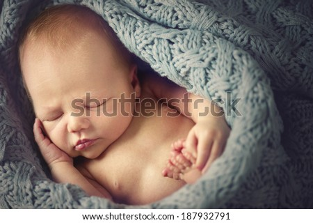 Sleeping Newborn Baby wrapped in a blanket