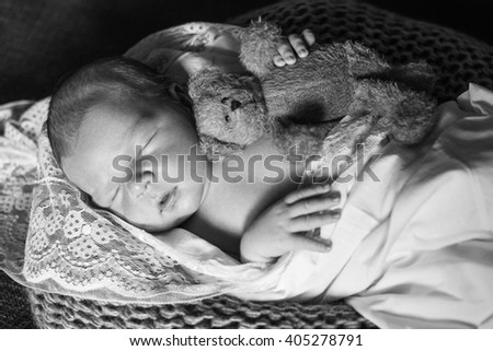 sleeping newborn baby wrapped in a blanket.  Newborn baby boy