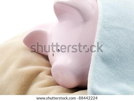 Sleeping piggy bank - stock photo
