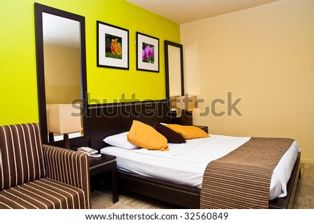 Sleeping room in a hotel Photos on the wall made by author - stock photo