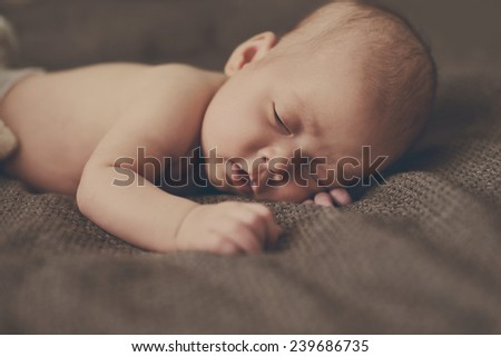 sleeping sweet newborn laying on the tummy - stock photo