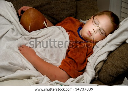 Sleeping with a Football - stock photo