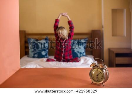 sleeping woman and alarm clock - stock photo