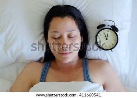 Sleeping Woman and clock