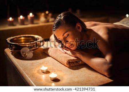 Sleeping woman in beauty spa - stock photo