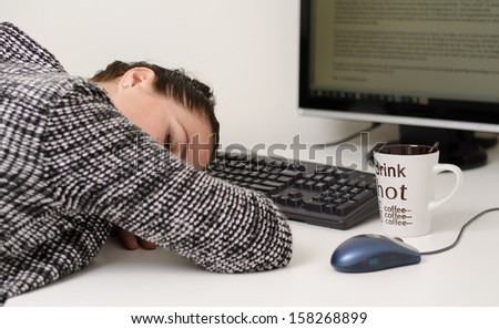 sleeping woman on desk with coffee - stock photo