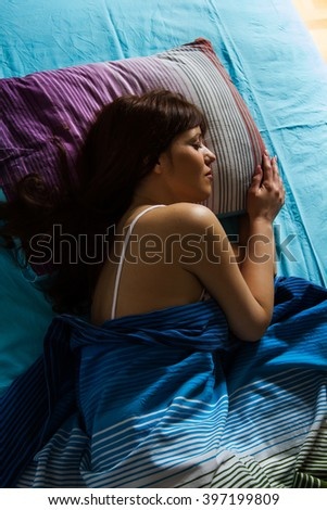Sleeping woman, young beautiful caucasian female sleep in the bed. - stock photo