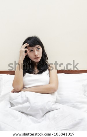 Sleepless woman thinking something on the bed - stock photo