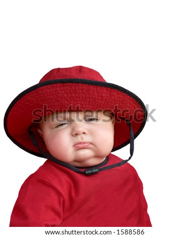 Sleepy baby in red hat. - stock photo