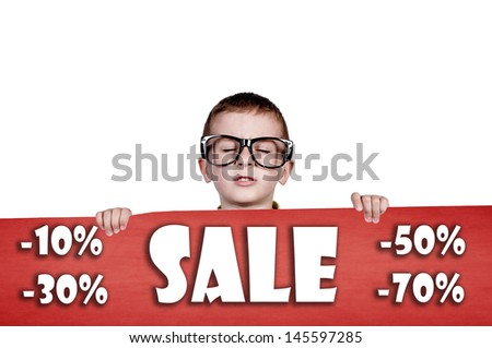 Sleepy boy holding red paper with sale text  - stock photo