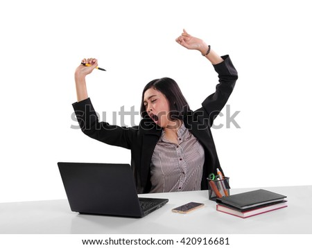 Sleepy business woman yawning and stretching while sitting on her work desk, isolated on white background - stock photo