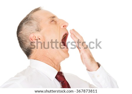 Sleepy businessman yawning - stock photo