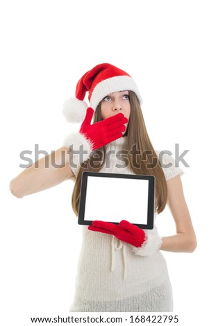 Sleepy cute Caucasian teenage Santa girl showing tablet computer with blank screen looking up yawning isolated on white background. Christmas and technology concepts. - stock photo