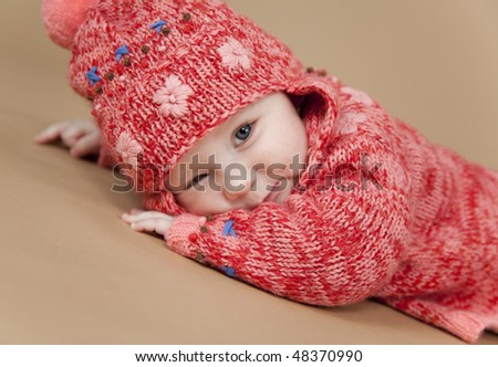 Sleepy girl wearing a wooden clothes - stock photo