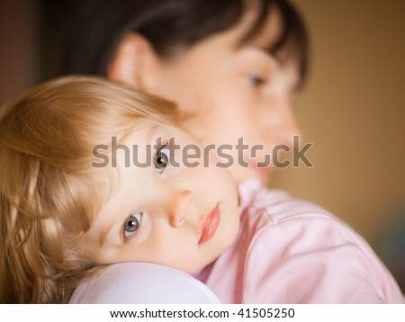 Sleepy little child with mom - shallow DOF, focus on eyes