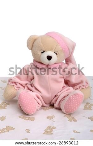 Sleepy looking teddy bear in pink pyjamas - stock photo