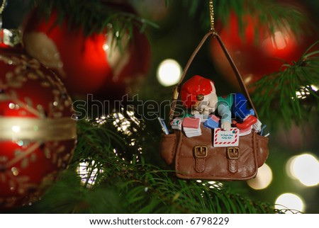 sleepy mailman on christmas tree - stock photo