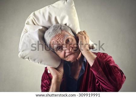 Sleepy man holding a pillow - stock photo