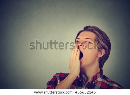 sleepy man yawning  - stock photo