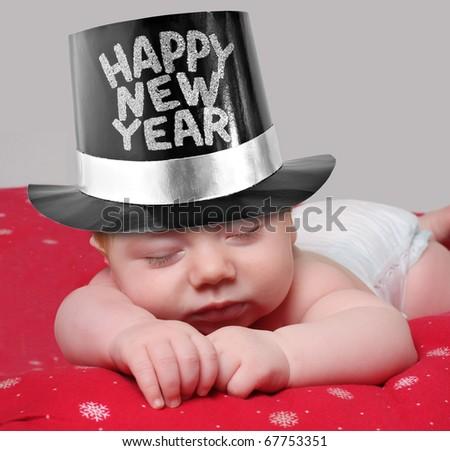 Sleepy new year baby - stock photo