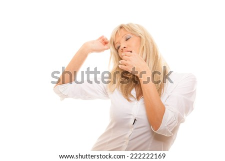 Sleepy tired mature business woman yawning covering her mouth with hand isolated on white