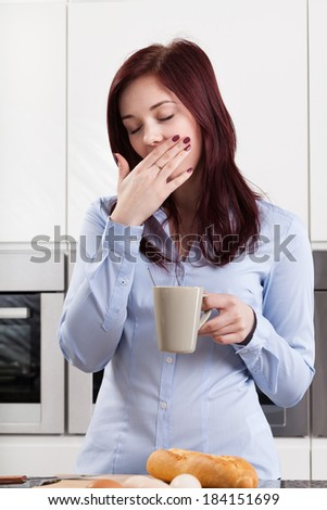 Sleepy woman drinking coffee in the morning