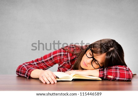 Sleepy woman on the table - stock photo