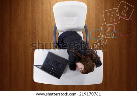 sleepy young businesswoman at work being lazy or overworked - stock photo