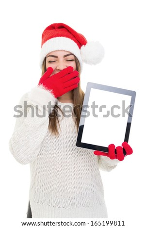 Sleepy young Caucasian woman with Santa hat showing tablet computer with blank screen. Isolated on white background. Copy space available on tablet screen.  - stock photo