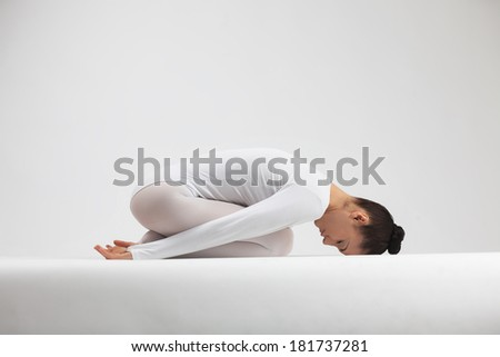 slender beauty shows yoga - stock photo